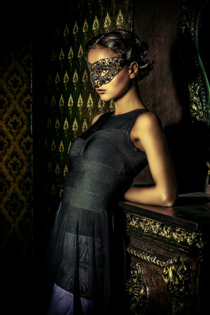 girl models: Beautiful mysterious stranger girl in venetian mask. Carnival, masquerade. Jewellery, gems. Stock Photo