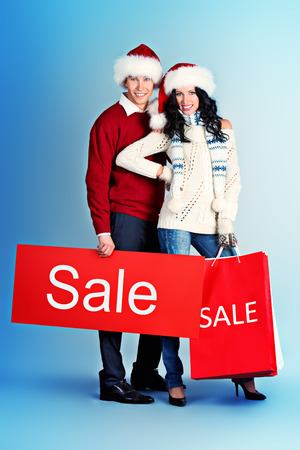 Full length portrait of a happy young people standing with a lot of shopping bags. Sale.  photo