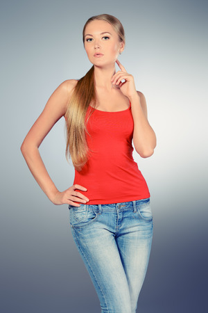 slender: Portrait of a young slender woman wearing jeans.