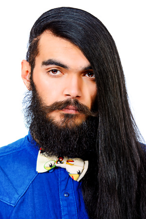 long haired:  Portrait of a young brunet man with a beard and long haired. Hairstyle. Isolated over white.