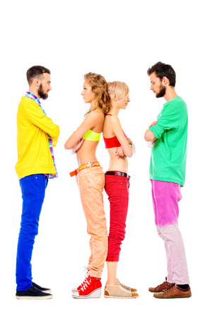 sort out: Two couples of young people standing and looking at each other. Relationships. Isolated over white.