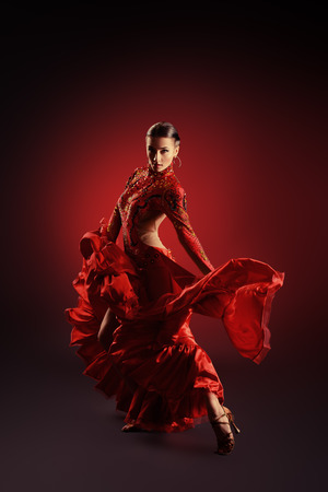 Beautiful professional dancer performs latino dance. Passion and expression. photo