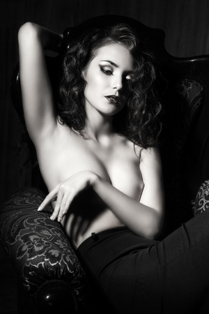 nude art model: Black-and-white portrait of a stunning sensual nude woman.
