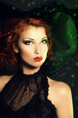 Portrait of an enchanting witch woman, beautiful and glamorous. Halloween.