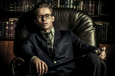 Respectable handsome man in his office. Classic vintage style. photo