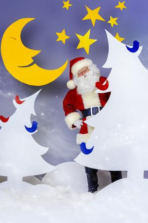 full length: Santa Claus in a cartoon fairy snowy forest. Full length portrait. Stock Photo