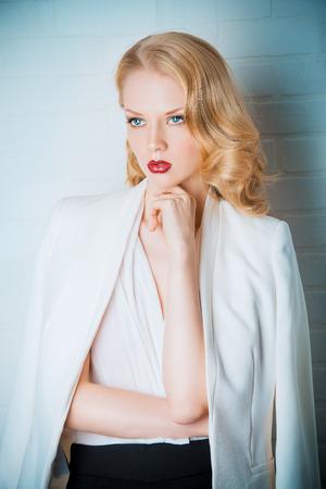 Fashion shot of a glamorous blonde woman. Successful business lady. photo