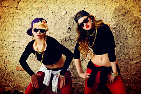 urban dance: Modern hip-hop dancers over brick wall. Urban lifestyle.