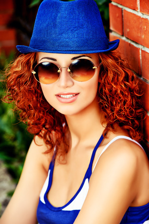 redhaired: Attractive young woman beautiful foxy hair outdoors. Beauty, fashion.