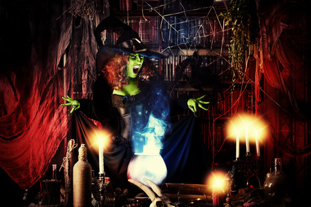 scary girl: Fairy wicked witch in the wizarding lair. Magic. Halloween.