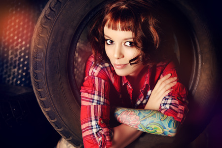 stunning: Stunningly young woman posing in the old garage.