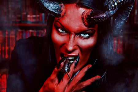 Horned Devil with insects in the mouth photo