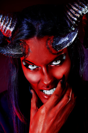 Portrait of a devil with horns photo
