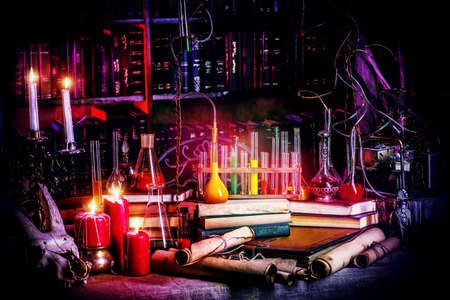 experiments: Medieval alchemist laboratory. Halloween. Fairy-tale interior. Stock Photo