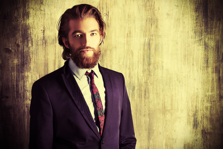Respectable handsome man in a suit smiles at camera. Mens fashion.