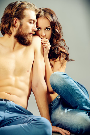 Fashion portrait of a beautiful tender lovers. Denim style. photo