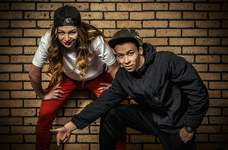 Two young modern dancers posing together. Urban lifestyle. Hip-hop generation. photo