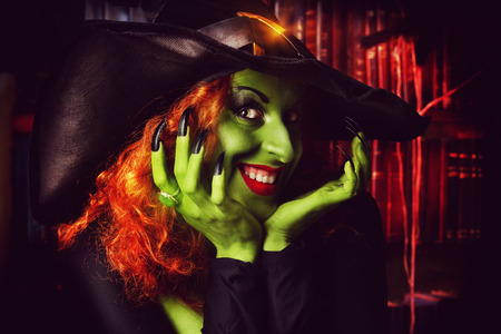 Close-up portrait of a fairy wicked witch in the wizarding lair. Magic. Halloween. photo