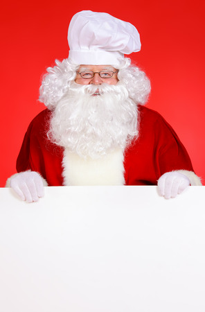 Cook Santa Claus with white message board photo