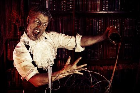 medieval medicine: Crazy old man medieval scientist working in his laboratory. Alchemist. Halloween.