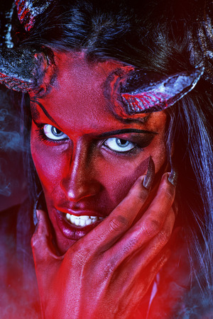 Portrait of a devil with horns. Fantasy. Art project. photo