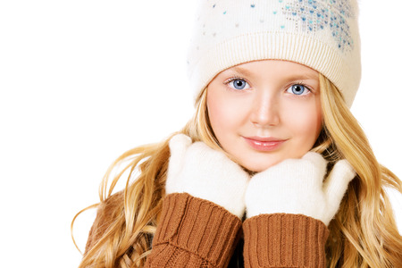 warm clothing: Portrait of a pretty ten years girl in warm clothes smiling at camera. Isolated over white.