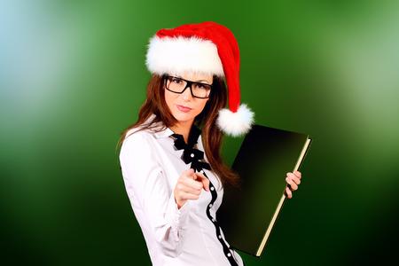 Portrait of a strict female teacher in Christmas cap.  Education. photo