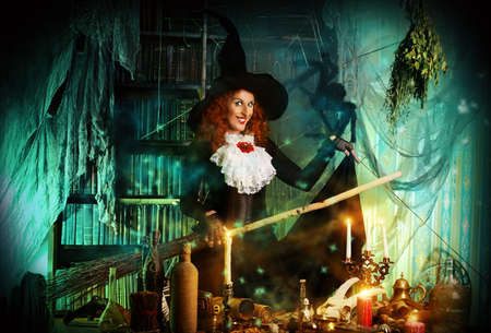 halloween witch: Attractive witch in the wizarding lair. Fairytales. Halloween.