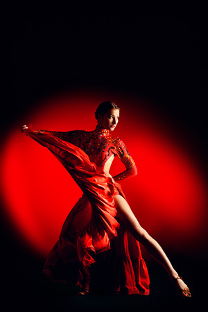 dancing girl: Beautiful professional dancer performs latino dance. Passion and expression.
