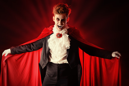 vampire teeth: Handsome bloodthirsty vampire. Halloween. Dracula costume.