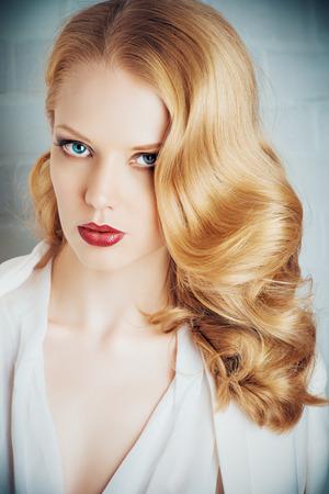 hairdo: Fashion shot of a glamorous blonde woman with retro make-up and hairdo.