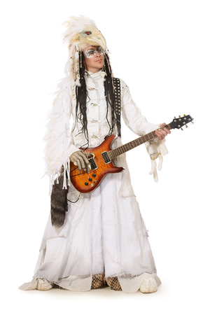 Handsome rock musician in a scenic suit of white raven. Isolated over white. photo