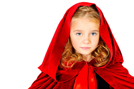 costumes: Beautiful little girl in a red raincoat with a hood. Little Red Riding Hood. Isolated over white.
