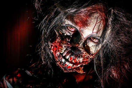 Close-up portrait of a scary bloody zombie girl. Horror. Halloween. photo