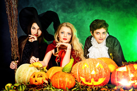 Children at the Halloween party. Traditional costumes and pumpkins decoration. Autumn holidays. photo