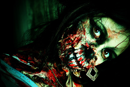 thriller: Close-up portrait of a scary bloody zombie girl. Horror. Halloween. Stock Photo