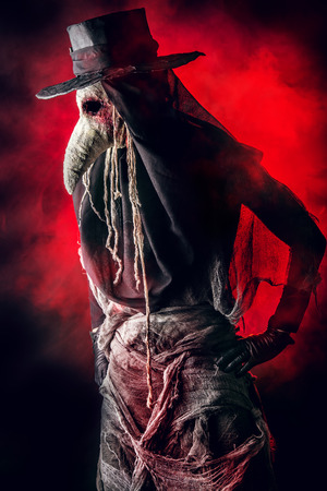horror background: Terrible plague doctor. Medieval Europe. Halloween. Stock Photo