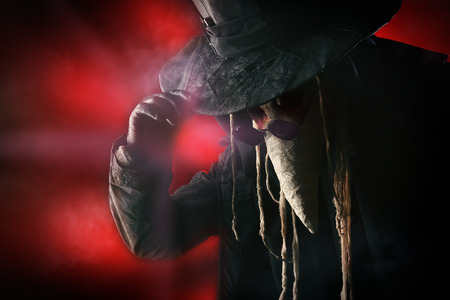 Terrible plague doctor. Medieval Europe. Halloween. photo