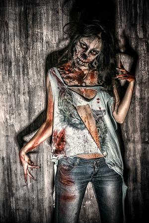 Furious bloody zombie girl. Horror. Halloween. photo