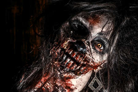 horror: Close-up portrait of a scary bloody zombie girl. Horror. Halloween. Stock Photo