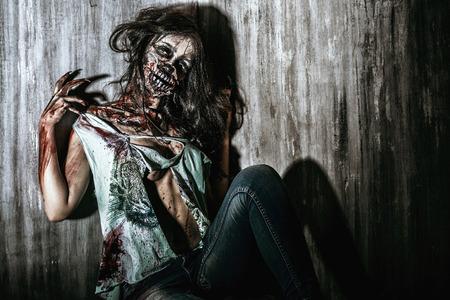 Furious bloody zombie girl. Horror. Halloween. Stock Photo