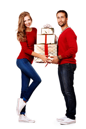Two happy young people in love give each other gifts. Isolated over white. photo