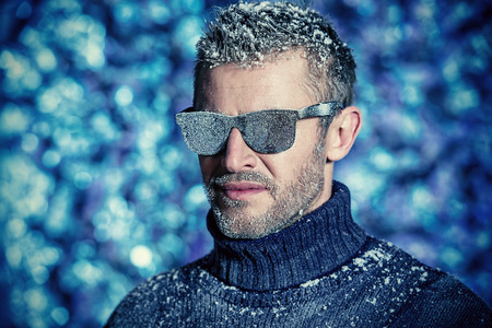 manly man: Portrait of a handsome brutal man dressed in winter clothes, covered with frost. Stock Photo