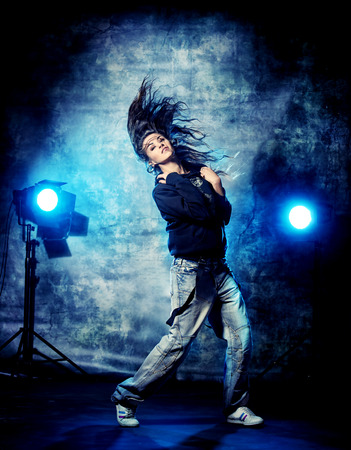 Modern hip-hop dancer over grunge background. photo