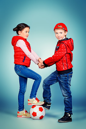 Full length portrait of modern boy and girl standing together. Fashion. photo