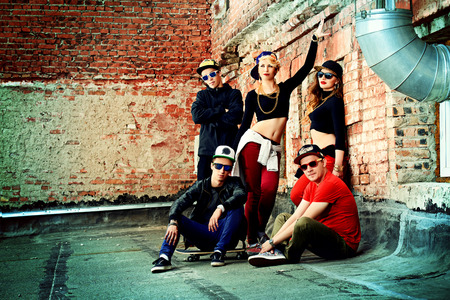 urban dance: Group of young modern people posing together with fun. Urban lifestyle. Hip-hop generation.