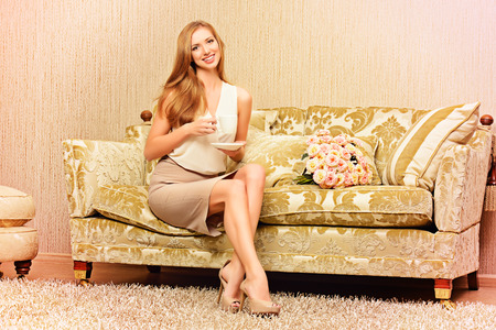 Charming young woman in a room with expensive classic interior. Interior. Furniture. photo