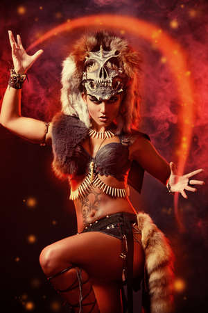 sexy halloween girl: Amazing bellicose Amazon woman in battle. Ancient times. Fantasy. Stock Photo