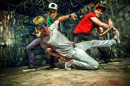 Modern dancers dancing in the garage. Urban lifestyle. Hip-hop generation. photo