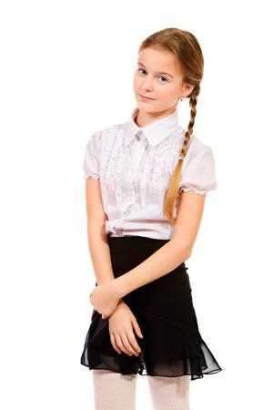 colegiala: Retrato de un vestido con uniforme de colegiala diez años. Aislado en blanco.